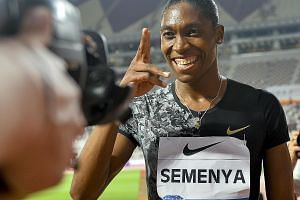 South African runner Caster Semenya celebrating in front of the camera after winning the women's 800m race by a margin of almost three seconds at the Diamond League athletics meet in Doha on Friday. caption.