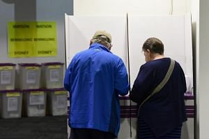 Voters place their early votes at a pre-polling booth at Central Station, Sydney, Australia, on April 29, 2019.