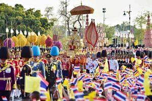 Thousands of Thais from across the country descended on the inner Bangkok to catch sight of newly anointed King Maha Vajiralongkorn in a symbolic procession around the capital.