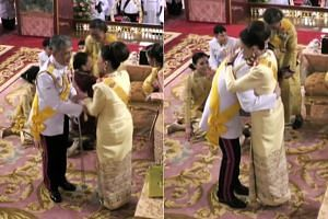 Thailand's King Maha Vajiralongkorn hugs his sister, Princess Ubolratana, during a ceremony in the Grand Palace in Bangkok on May 3, 2019, ahead of his royal coronation.