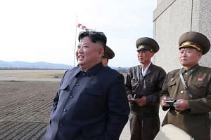Kim observing flight drills by combat pilots at an undisclosed location.
