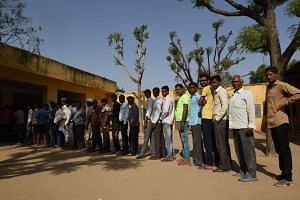 Indian voters queue to cast their vote at a polling station during India's general election in village Charanwala, in Sanganer on the outskirts of Jaipur on May 6, 2019.