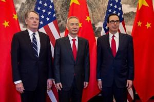 China's Vice-Premier Liu He (centre) with US Treasury Secretary Steven Mnuchin (right) and US Trade Representative Robert Lighthizer at Diaoyutai State Guesthouse in Beijing, on March 28, 2019.
