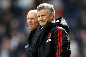 Manchester United manager Ole Gunnar Solskjaer looks dejected after the match at John Smith's Stadium, Huddersfield, Britain, on May 5, 2019.