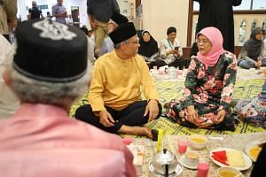 President Halimah Yacob and Minister-in-charge of Muslim Affairs Masagos Zulkifli join Kampong Glam residents for the breaking of fast at Masjid Hajjah Fatimah on May 7, 2019.