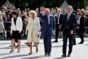 Britain's Prince Charles (second right) and his wife Camilla are escorted by Berlin's Mayor Michael Mueller and his wife Claudia Mueller during a visit to the Brandenburg Gate in Berlin, Germany May 7, 2019.