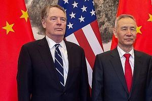 US Trade Representative Robert Lighthizer with China's Vice-Premier Liu He in Beijing in March. The Chinese delegation, including Mr He, will head to Washington for trade talks, which will begin tomorrow, a day later than previously scheduled.