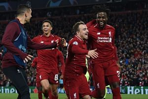 Liverpool's Belgium striker Divock Origi (right) celebrates wtih Liverpool's Swiss midfielder Xherdan Shaqiri after scoring their fourth goal.