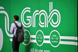 Grab may raise capital for the two businesses separately in order to spin off one or both of them at a later date, the Financial Times said.