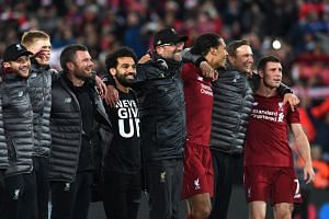 Liverpool players and manager Jurgen Klopp (fourth from right) celebrating after winning 4-0 in the Champions League semi-final second leg against Barcelona.