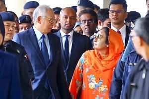 Former Malaysian prime minister Najib Razak and his wife Rosmah Mansor leaving the Kuala Lumpur Courts Complex together on Oct 4, 2018.