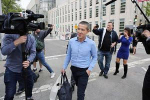 Former Goldman Sachs banker Roger Ng leaving US District Court in New York on Monday. He has pleaded not guilty to charges of helping Malaysia's former prime minister and other individuals embezzle at least $3.7 million from state fund 1Malaysia Deve