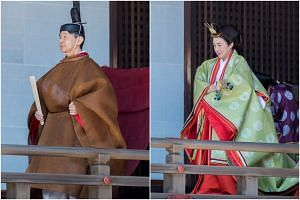 Japan's Emperor Naruhito and Empress Masako donned traditional robes for rituals in which he reported to Shinto gods the date of two important ceremonies later this year.