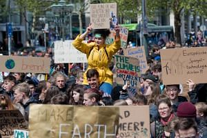 """Students taking part in a protest as part of the """"Fridays for Future"""" movement to protest against the lack of climate awareness in Hanover, Germany, on May 3, 2019."""
