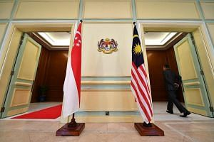The flags of Malaysia and Singapore at a multi-purpose hall for a joint press conference at the Perdana Putra Building in Kuala Lumpur, on April 9, 2019.