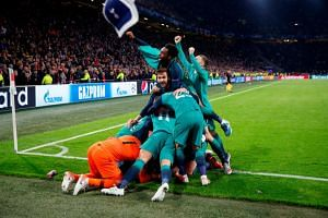 Tottenham's Lucas Moura celebrates scoring their third goal to complete his hat-trick with Fernando Llorente, Danny Rose and team mates.