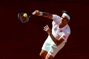 Roger Federer of Switzerland in action against Gael Monfils of France during their third round match of the Mutua Madrid Open tennis tournament at the Caja Magica complex in Madrid, Spain, on May 9, 2019.