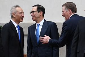 (From left) Chinese Vice-Premier Liu He with US Treasury Secretary Steven Mnuchin and US Trade Representative Robert Lighthizer as he arrives at the office of the US Trade Representative in Washington for further trade talks on May 10, 2019.