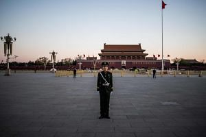 A paramilitary policeman stands outside Beijing's Great Hall of the People, on March 15, 2019.