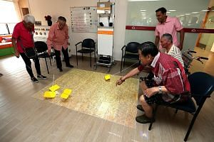 Patients playing games at HCA Hospice Care's new premises at Kwong Wai Shiu Hospital, which officially opened yesterday. The hospice, which moved from its previous location in Jalan Tan Tock Seng in November last year, has waived charges for all its