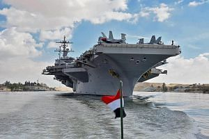 The USS Abraham Lincoln aircraft carrier sailing south in the Suez Canal, near Ismailia city east of Cairo, on Thursday. PHOTO: AGENCE FRANCE-PRESSE