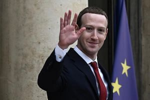 Facebook chief Mark Zuckerberg met French President Emmanuel Macron at the Elysee Palace amid pressure to crack down on the spread of disinformation as well as a call from a co-founder of Facebook for the California-based giant to be broken up.