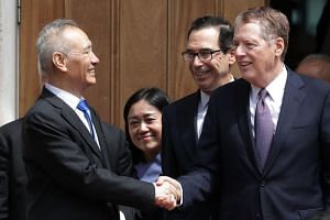 Chinese Vice-Premier Liu He (left) says goodbye to US Treasury Secretary Steven Mnuchin (centre) and US Trade Representative Robert Lighthizer as they break from meetings at the USTR offices, on May 10, 2019 in Washington.
