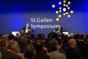 (From left) Symposium chairman Dominic Barton and Deputy Prime Minister Heng Swee Keat at the 49th St Gallen Symposium in Switzerland on May 9, 2019.