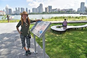 The heritage trail's project manager Teresa Teo Guttensohn next to a trail marker,