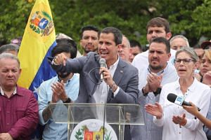 Venezuelan opposition leader Juan Guaido said he had received word from China that the country would join a diplomatic effort between European and Latin American countries to negotiate an end to the crisis.