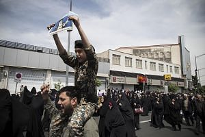 Iranian demonstrators taking part in an anti-US rally in Teheran to show their support for Iran's decision to pull out from some parts of the 2015 nuclear agreement. Last Wednesday, the Iranian government said it would begin to withdraw from key aspe