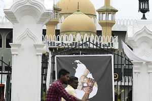 A poster showing four hands with different religious symbols. It was put up in honour of the victims of the Zion Church suicide bomb attack in Kattankudy on April 26. Sri Lanka had ignored the slow, deep process of radicalisation behind the attacks,