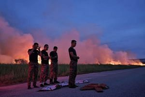 One of the photos shows the group of Fire and Rescue Department personnel carrying out prayers, using their uniforms as prayer mats.
