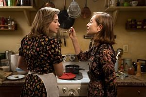 A still from the movie Greta, where its eponymous lead played by Isabelle Huppert (right) befriends a young waitress, Frances (Chloe Grace Moretz) and grows obsessed with her.