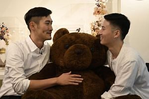 Taiwanese couple Shane Lin (left) and Marc Yuan are among hundreds of same-sex couples who have made reservations to register with government agencies on May 24 for what they hope will be a marriage.