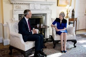 Jens Stoltenberg, secretary general of the North Atlantic Treaty Organization (NATO), left, speaks with British Prime Minister Theresa May at a bilateral meeting at No. 10 Downing Street in London on Tuesday, May 14, 2019.