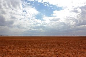 A barren paddock stretches into the distance north of the city of Mildura in the Mallee region of Australia on April 24, 2019.