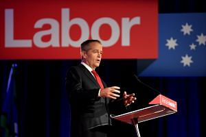 Labor leader Bill Shorten has appealed to disillusioned voters, promising to make the country's taxation system fairer and to fight climate change.