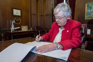 Governor Kay Ivey, a Republican, signed the measure a day after the Republican-controlled state Senate approved the ban and rejected a provision to allow abortions for women and girls impregnated through rape or incest.