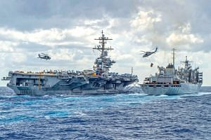 Aircraft carrier USS Abraham Lincoln conducting a replenishment-at-sea with the fast combat support ship USNS Arctic. President Donald Trump has said he does not favour the US getting involved in endless wars abroad. He is also building up the milita