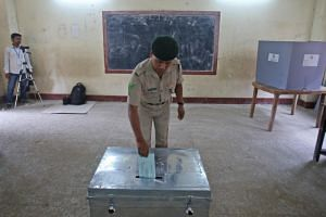 A police officer casts his postal ballot at a polling station in Agartala, India, on April 8, 2019.