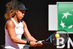 Naomi Osaka was due to meet Madrid Open champion and sixth seed Kiki Bertens for a place in the final four in Rome.