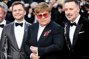 (From left) British actor Taron Egerton, British singer Elton John and his husband, Canadian filmmaker David Furnish, at the premiere of Rocketman during the 72nd Cannes International Film Festival at the Palais des Festivals on May 16, 2019.