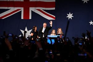 Australia's Prime Minister Scott Morrison with his wife Jenny and children Abbey and Lily at the Sofitel-Wentworth hotel in Sydney on May 18, 2019, after winning the federal election.