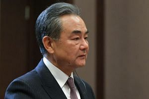 China's senior diplomat Wang Yi said the United States should not go