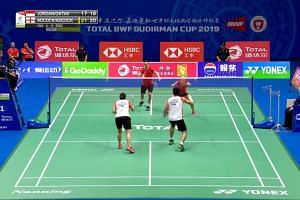 Engladnd's Chris and Gabrielle Adcock (red) in action against Indonesia's Praveen Jordan and Melati Daeva Oktavianti during their Sudirman Cup clash.