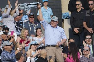 Mr Bill Shorten and his wife Chloe facing the media yesterday. The opposition Labor leader is stepping down after losing the election. PHOTO: DPA Australian Prime Minister Scott Morrison waving to the crowd at a rugby match in Sydney yesterday, a day