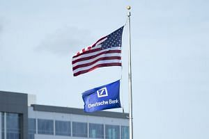 """Flags near Deutsche Bank's offices in Jacksonville, United States, May 8, 2019. Anti-money laundering specialists at Deutsche Bank proposed filing """"suspicious activity reports"""" about transactions connected to President Donald Trump and his son-"""