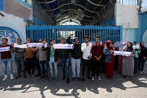 Palestinian students take part in a protest in Gaza City. The economic conference in June will bring together government and business leaders to help jump-start the economic portion of the broader US peace initiative.