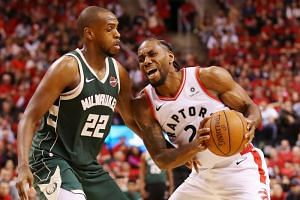 The Toronto Raptors' Kawhi Leonard in action against the Milwaukee Bucks' Khris Middleton during the NBA Eastern Conference finals at Scotiabank Arena in Toronto, Canada, on May 19, 2019.